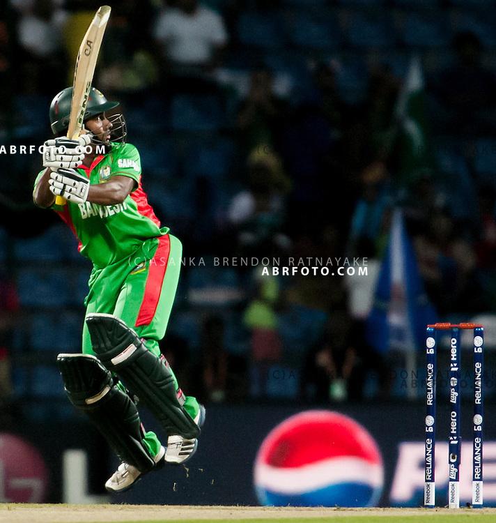 Bangladeshi batsmen play a shot mid air during the ICC world Twenty20 Cricket held in Sri Lanka.
