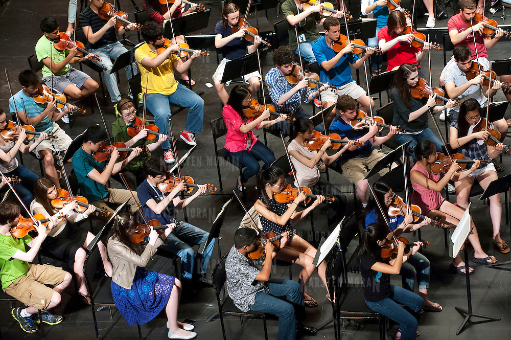 July 9, 2013 - Purchase, NY : Members of the National Youth Orchestra of the United States of America rehearse with conductor Valery Gergiev (not pictured) at SUNY Purchase's Performing Arts Center in Westchester on Tuesday afternoon. The Orchestra, a new project of Carnegie Hall's Weill Music Institute, is comprised of musicians aged 16-19, hand-picked from across the country. The program -- and orchestra -- will kick off its inaugural season with a performance at SUNY Purchase on Thursday evening, and then head off to perform in Washington DC,  Moscow, St. Petersburg, and London. CREDIT: Karsten Moran for The New York Times