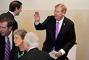U.S. Johnny Isakson, R-Ga., waves as he arrives for a memorial service for Georgia Gov. Carl Sanders at Second Ponce de Leon Baptist Church on Saturday, Nov. 22, 2014, in Atlanta. Six living Georgia governors attending the service included current Gov. Nathan Deal and former governors Sonny Perdue, Roy Barnes, Zell Miller, Joe Frank Harris and Jimmy Carter, as well as business, education and political leaders. Photo by David Tulis