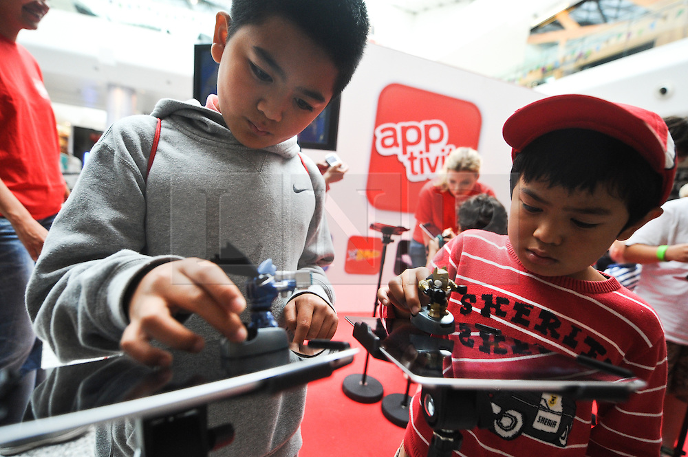 © Licensed to London News Pictures. 21/08/2012. Photo call for Mattel's Apptivity range, of toys that interact with iPad games at Westfield London today 21 August 2012. Photo credit :  Thomas Campean/LNP