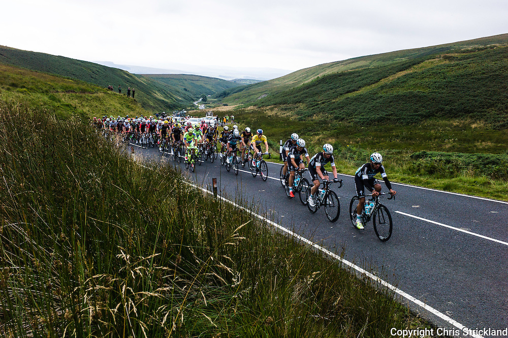 Wauchope, Hawick, Scottish Borders, UK. 8th September 2015. The Tour of Britain road cycle race makes its way north through Liddesdale on Stage 3 of the race. The stage began in Cockermouth Cumbria and climaxes at Floors Castle in the Scottish Borders.