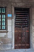 Beautiful ancient doors on the old Qilou buildings on En Ning Road in Guangzhou.