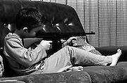 Neville on Couch with Gun, High Wycombe, UK, 1980s.