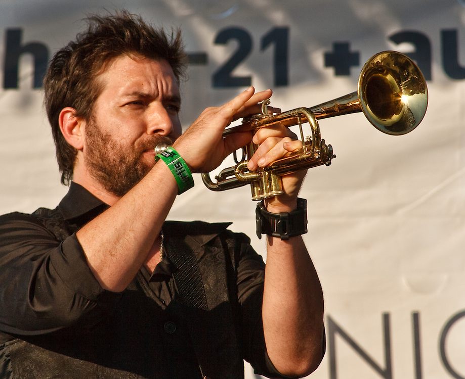 Bob Schneider plays trumpet during his performance at Auditorium Shores during SXSW 2009 in Austin, TX.
