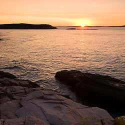 Sunrise over Frenchman Bay as seen from the rock ledges along Ocean Drive in Maine's Acadia National Park.  Mount Desert Island.