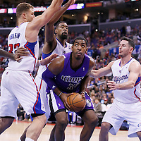 23 November 2013: Los Angeles Clippers power forward Blake Griffin (32), Los Angeles Clippers center DeAndre Jordan (6) and Los Angeles Clippers shooting guard J.J. Redick (4) defend on Sacramento Kings power forward Jason Thompson (34) during the Los Angeles Clippers 103-102 victory over the Sacramento Kings at the Staples Center, Los Angeles, California, USA.