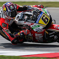 German MotoGP rider Stefan Bradl of LCR Honda takes a corner during the qualifying session of the 2014 Malaysian Motorcycling Grand Prix in Sepang International Circuit near Kuala Lumpur, Malaysia, 25 October 2014. The Malaysian Motorcycling Grand Prix will take place from 24 to 26 October 2014.