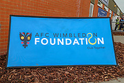 AFC Wimbledon foundation sign during the EFL Sky Bet League 1 match between AFC Wimbledon and Accrington Stanley at the Cherry Red Records Stadium, Kingston, England on 6 April 2019.