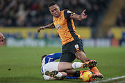 Abel Hernández (Hull City) is tackled during the Sky Bet Championship match between Hull City and Sheffield Wednesday at the KC Stadium, Kingston upon Hull, England on 26 February 2016. Photo by Mark P Doherty.