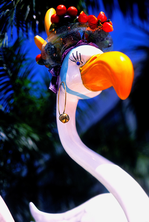 A flamingo sculpture, one of a series of 7-feet high, fiberglass flamingos created in 2002 as part of the City of Miami Beach's Art in Public Spaces program. Each statue was decorated differently by various local artists -- this one affectionately references Brazilian song and dance woman Carmen Miranda's famous fruit-bedecked headdresses.