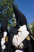 Hooded penitents (Nazarenos) gather for Seville's annual Semana Santa Easter passion processions.