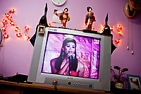 A contestant from a past Miss International Ladyboy competition graces a television screen in Pattaya, Thailand.