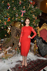 ANNA KENDRICK at a party to celebrate the unveiling of the 2014 Claridge's Christmas tree by Dolce & Gabbana at Claridge's, Brook Street, London on 19th November 2014.