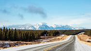 Scenic view of Saint Elias Mountains along the Alaska Highway near Kluane Lake in the Yukon Territory. Winter. Morning.
