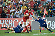 Canada's Matt Mullins breaks past USA's Ben Pinkelman during the HSBC World Rugby Sevens Series, Singapore, Cup Final match USA -V- Canada  at The National Stadium, Singapore on Sunday, April 16, 2017. (Steve Flynn/Image of Sport)