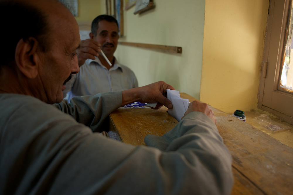 An egyptian man casts his vote in a polling station at Masr El Gdeeda district in Cairo.