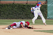 August 17, 2017 - Chicago, IL, USA - The Cincinnati Reds' Eugenio Suarez steals second base underneath Chicago Cubs second baseman Javier Baez (9) during the eighth inning at Wrigley Field in Chicago on Thursday, Aug. 17, 2017. The Reds won, 13-10. (Credit Image: © Armando L. Sanchez/TNS via ZUMA Wire)