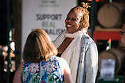 "Chef Nyanyika Banda shares a laugh with host Lindsay Christians before the ""Corner Table Podcast"" recording at Old Sugar Distillery in Madison, Wisconsin, Tuesday, June 18, 2019."