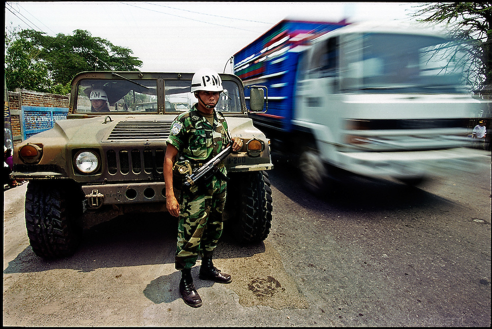 COYOLITO (Tejutla), CHALATENANGO, EL SALVADOR- MAY 2000: Heavily armed Federal Army military police soldiers guard the streets surrounding a school where the government set-up a free clinic. The troops are needed they say to keep peace and protect the medicine and doctors. The clinics, the government said, is one way they can help ease the long tensions of the civil war in FMLN, Farabundo Martí National Liberation Front, controlled Chalatenango state.  (Photo by Robert Falcetti). .