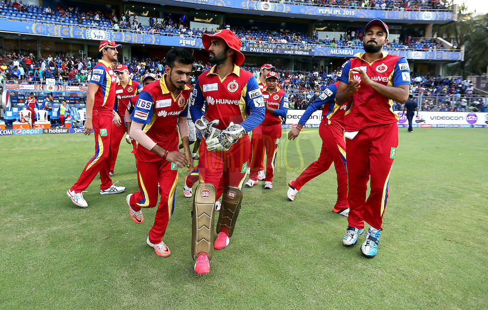 Royal Challengers Bangalore players run to take the feild  during match 46 of the Pepsi IPL 2015 (Indian Premier League) between The Mumbai Indians and The Royal Challengers Bangalore held at the Wankhede Stadium in Mumbai, India on the 10th May 2015.<br /> <br /> Photo by:  Sandeep Shetty / SPORTZPICS / IPL