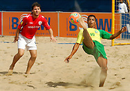 07 December 2006, Brazil's Benjamin da Silva attempts a bicycle kick as England's Terrence Bowes looks on during the first game of the Vodacom Pro Beach Soccer Tour at Durban's Bay of Plenty on Thursday. Brazil won the game 10 - 3. Picture: Shayne Robinson, PhotoWire Africa
