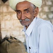 Portrait of man in turban in village in Rajasthan