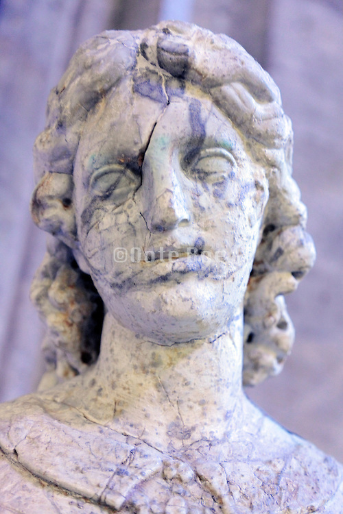 face close up of an ancient female marble sculpture, at the Vatican museum Rome Italy