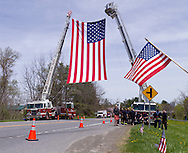 Hurley, New York  - A large American flag hangs over Route 209, where the public lined up to honor U.S. Army Sgt. Shawn M. Farrell II on May 7, 2014. Farrell died April 28 when forces attacked his unit with small arms fire in Afghanistan.