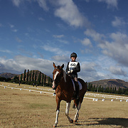 Sarah Liley riding Country Colour's prepares for the Dressage event  at the Wakatipu One Day Horse Trials,  Queenstown, Otago, New Zealand. 15th January 2012. Photo Tim Clayton