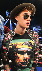LAS VEGAS, NV - MAY 3: Canadian pop musician Justin Bieber in the ring before the start of the fight between Floyd Mayweather Jr. and Marcos Maidana at the MGM Grand Garden Arena on May 3, 2014 in Las Vegas, Nevada. (Photo by Ed Mulholland/Golden Boy/Golden Boy via Getty Images) *** Local Caption ***Justin Bieber