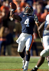 Virginia cornerback Vic Hall (4) throws a 35 yard halfback pass to Virginia wide receiver Chris Gorham (39) setting up a Virginia touchdown.  The Virginia Cavaliers defeated the Connecticut Huskies 17-16 at Scott Stadium in Charlottesville, VA on October 13, 2007