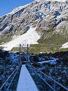 A suspension bridge on the Hooker Valley Track, Aoraki/Mt. Cook National Park, New Zealand.