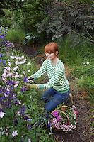 Woman picking flowers in garden