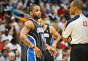 24 April 2011: Orlando's Jameer Nelson (left) and official Dan Crawford in Atlanta Hawks 88-85 victory over the Orlando Magic in Eastern Conference First Round Game 4 at Philips Arena in Atlanta, GA.