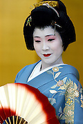 Geisha Yoshimaru practices a dance before work in Tokyo, Japan.