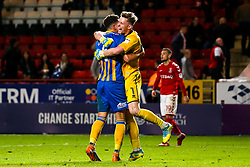 Dean Henderson of Shrewsbury Town hugs Ben Godfrey of Shrewsbury Town after their side beat Charlton Athletic in the first leg of the League One Playoff Semi-Final - Mandatory by-line: Robbie Stephenson/JMP - 10/05/2018 - FOOTBALL - The Valley - Charlton, London, England - Charlton Athletic v Shrewsbury Town - Sky Bet League One