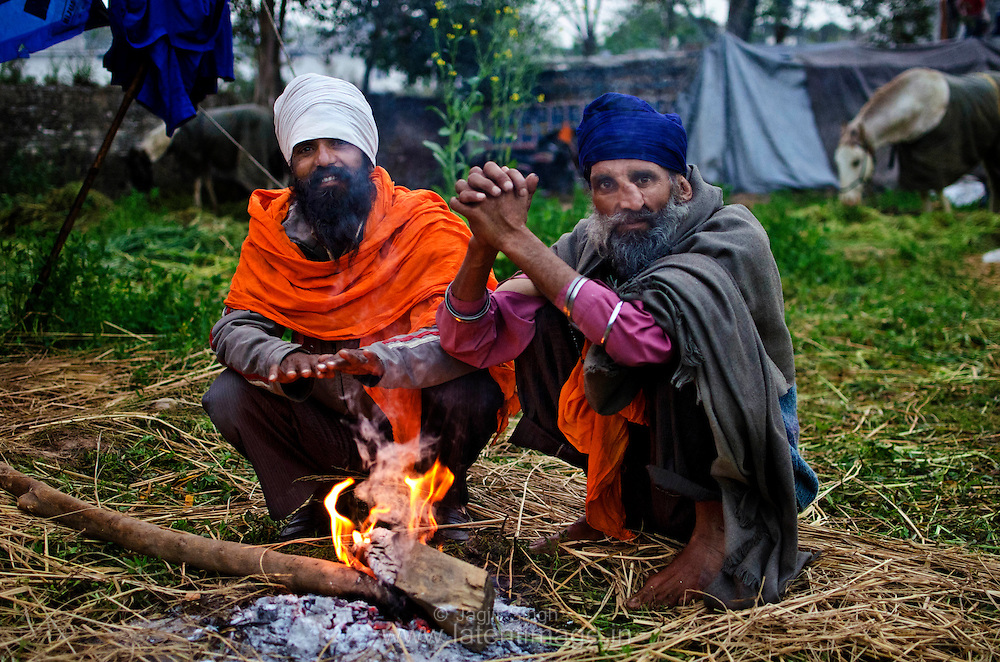 Nihang in front of fire in a cold morning during Hola Mohalla
