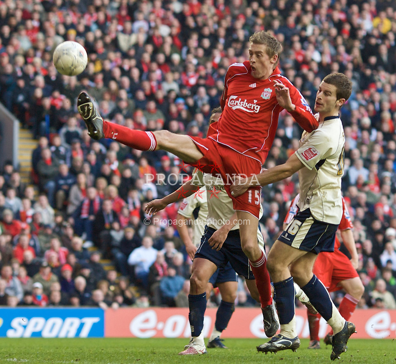 LIVERPOOL, ENGLAND - Saturday, February 16, 2008: Liverpool's Peter Crouch and Barnsley's Stephen Foster during the FA Cup 5th Round match at Anfield. (Photo by David Rawcliffe/Propaganda)