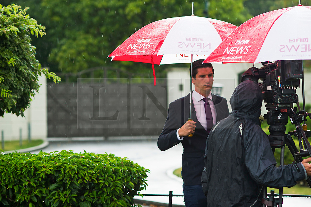 © Licensed to London News Pictures. FILE PICTURE. 14/08/2014. BBC news reporter DAN JOHNSON reporting at the entrance to the home of Cliff Richard at Charters estate in Sunninghilll, near Sunningdale, Berkshire  during a police raid by South Yorkshire Police, in connection in relation to an alleged historical sex offence. Dan Johnson has given Evidence at the High Court over a dispute between Cliff Richard and the BBC. Photo credit : Ben Cawthra/LNP