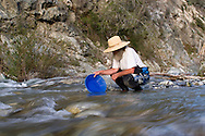 Steve nown as sluice box living on and panning for gold out of the East Fork River in California, Tuesday, March3, 2009.