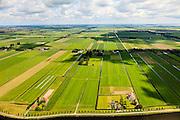 Nederland, Noord-Holland, Beemster, 14-06-2012;  De Beemster, 400 jaar 1612 - 2012. Overzicht met de Boven polder in de voorgrond, in NNO richting langs Jisperweg. In de voorgrond het Fort aan de Jisperweg en het Noordhollandsch kanaal (tevens Beemsterrringvaart). Middenbeemster aan de horizon. De 17e eeuwse droogmakerij, met haar  beroemde geometrische verkaveling, maakt deel uit van het wereld erfgoed (Unesco werelderfgoedlijst)..The famous geometrical well-ordered polder Beemster, 17th century  reclaimed landscape, Unesco world heritage. Fortress, part of the Defensive Line of Amsterdam also world heritage..luchtfoto (toeslag), aerial photo (additional fee required);.copyright foto/photo Siebe Swart