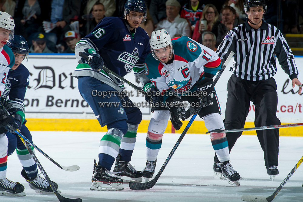 KELOWNA, CANADA - APRIL 25: Rodney Southam #17 of the Kelowna Rockets is stick checked by Alexander True #16 of the Seattle Thunderbirds on April 25, 2017 at Prospera Place in Kelowna, British Columbia, Canada.  (Photo by Marissa Baecker/Shoot the Breeze)  *** Local Caption ***