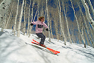 Jen catching air in trees at The Canyons, Park City, Utah USA