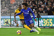 Wolverhampton Wanderers defender Willy Boly (15) holds up Chelsea Midfielder Willian during the Premier League match between Wolverhampton Wanderers and Chelsea at Molineux, Wolverhampton, England on 5 December 2018.