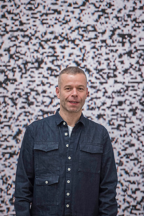 Wolfgang Tillmans with Sendeschluss/End of Broadcast IV, 2014 - . Tate Modern's new exhibition. Highlights include: large scale photographic works printed especially for this exhibition, including the four-meter tall Weed 2014 and dramatic seascapes such as The State We're In, A 2015;   New 'text and table' sculptures including Time Mirrored 3 2017, on display to the public for the first time; and slide projection Book for Architects 2014. The show is at Tate Modern from 15 February to 11 June 2017.