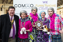 Windsor, UK. 5th March, 2019. Winners of the best fancy dress award in the 13th Windsor and Eton Flippin' Pancake Challenge pose with the Mayor of Windsor and Maidenhead Paul Lion after the race on Shrove Tuesday in aid of Alexander Devine Children's Hospice Service and Windsor Homeless Project.