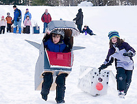 """Shark Bite"" Daegan Boucher and ""Fluffy"" Michelle Gallant compete in the Gilford Parks and Recreation cardboard box derby on Wednesday at the Gilford Outing Club as part of a week long winter celebration.  Boucher received a ""best use of cardboard"" ribbon and Gallant a ""most creative"" for their efforts.  (Karen Bobotas/for the Laconia Daily Sun)"