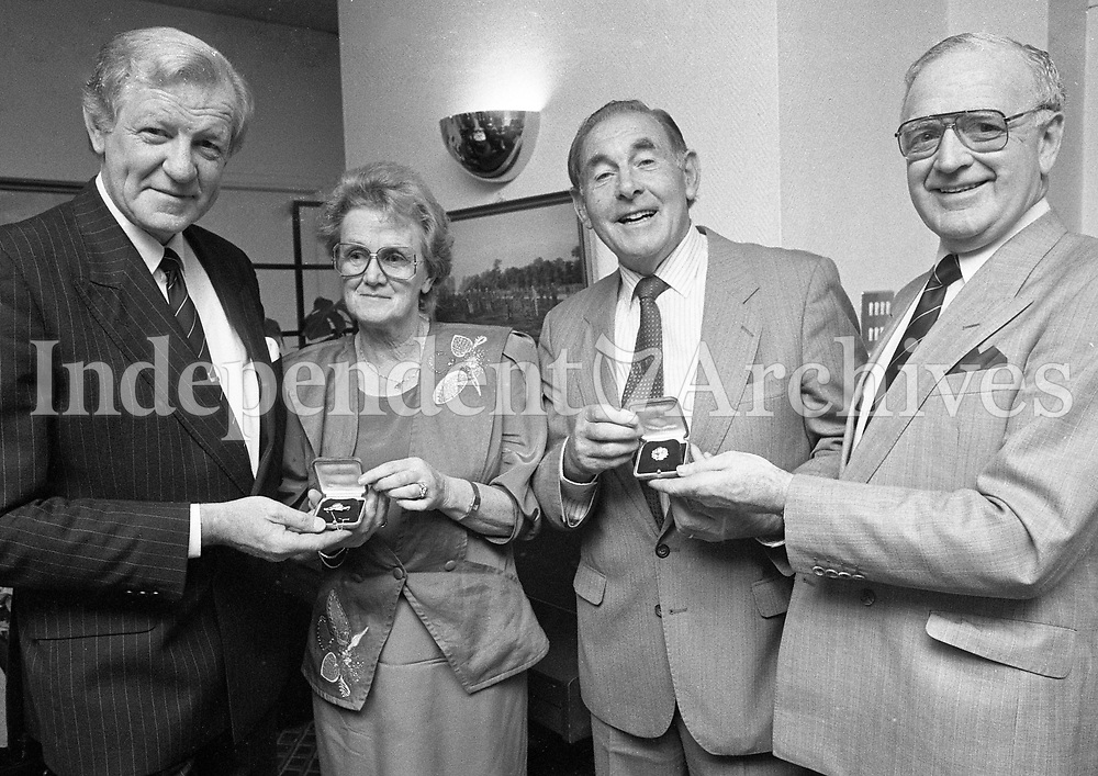 Christy O'Connor Snr pictured with his wife Mary when they were presented by (Left) Noel Harris, Captain Royal Dublin Golf Club and Garrett Kennedy, Honorary Secretary, to celebrate O'Connor's 30 yaer career as a Professional Golfer, circa October 1989 (Part of the Independent Newspapers Ireland/NLI Collection).
