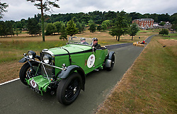 © Licensed to London News Pictures. 13/07/2015. Epsom, UK. PETER NEUMARK and GEOFFREY NEUMARK set off from Woodcote Park in their 1934 Talbot 105 Alpine. The start of The Royal Automobile Club 1000 Mile Trial 2015 at Woodcote Park in Epsom, Surrey. The event, which starts and finishes at Woodcote Park, takes a fleet of over 40 classic cars from around the world, through a 1000 mile trial around the UK.  Photo credit: Ben Cawthra/LNP