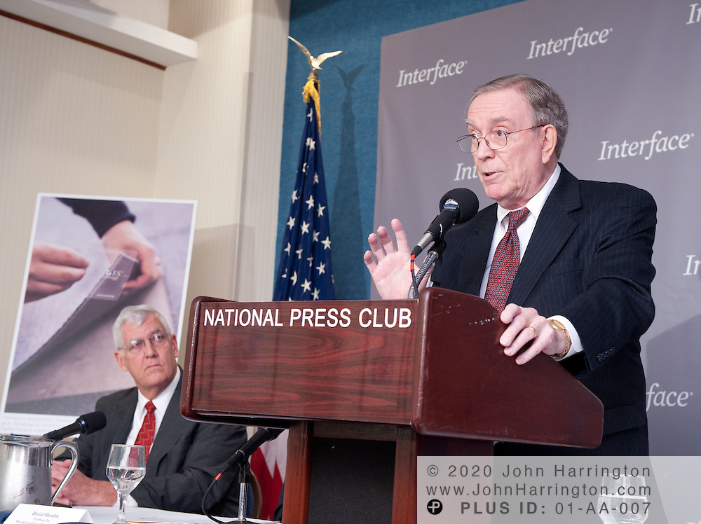 "Ray Anderson (right), chairman and founder of Interface, Inc. speaks at a press conference on the occasion of the company passing the halfway mark in its journey to ""Mission Zero"" - sustainability by 2020, Tuesday, November 9, 2010 at the National Press Club, as Alan Anderson (left), Director of the Concept Center and Chief Engineer of Payload Systems for Boeing Commercial Airplanes, looks on.  Interface announced it will offer third-party environmental product declarations on its carpet products worldwide by 2012, and Boeing is currently testing Interface products in its aircraft.."